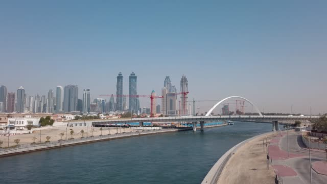 traffic on dubai water canal tolerance bridge in the uae - canal stock videos & royalty-free footage