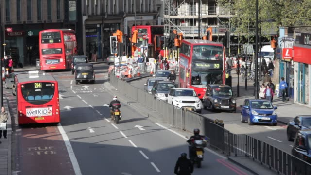traffic on euston road in london, uk. - road junction stock videos & royalty-free footage