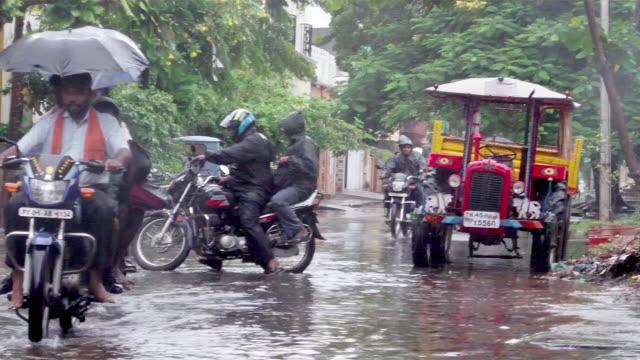 WS Traffic on flooded street after rain / Pundichery, Tamil Nadu, India