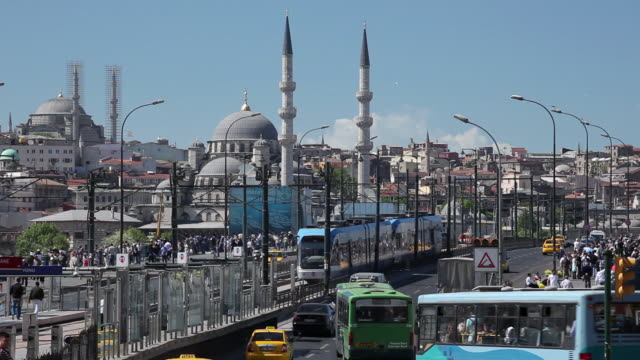 ws traffic on galata bridge, new mosque (yeni mosque) in background / istanbul, turkey - yeni cami mosque stock videos and b-roll footage