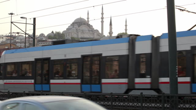 ws traffic on galata bridge, suleymaniye mosque in background / istanbul, turkey - suleymaniye mosque stock videos and b-roll footage