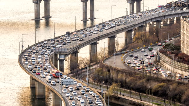 traffic on gangbyeon expressway at han river / mapo-gu, seoul, south korea - traffic jam stock videos & royalty-free footage