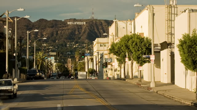 t/l, ws, traffic on gower street, hollywood hills in background, los angeles, california, usa - paramount pictures stock videos and b-roll footage