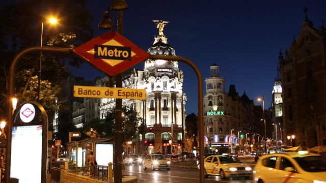 ws traffic on gran via and metropolis building illuminated at night, metro sign in foreground / madrid, spain - madrid stock videos & royalty-free footage