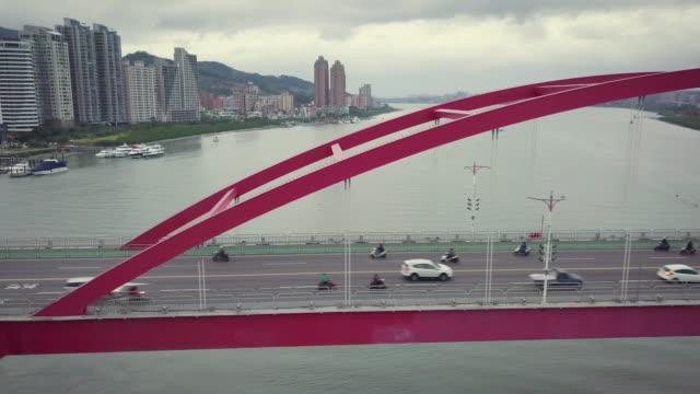 ws aerial pan traffic on guandu bridge, taipei, taiwan - arch bridge stock videos & royalty-free footage