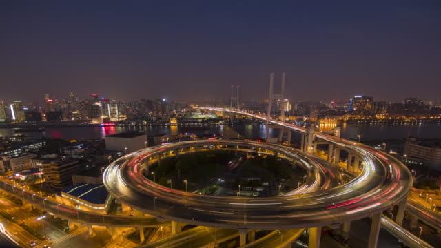 traffic on helix model bridge - helix bridge stock videos & royalty-free footage