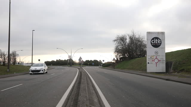 traffic on highway and a directional sign near the eurotunnel terminal in calais, france, on friday, jan. 1, 2021. the u.k. completed its divorce... - directional sign stock videos & royalty-free footage