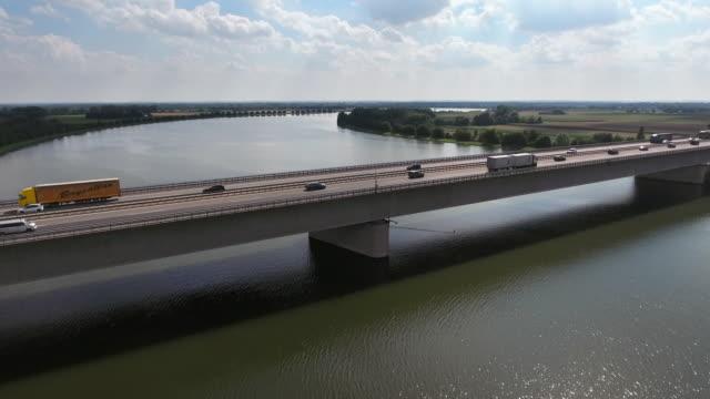 Traffic On Highway Bridge Over Big River