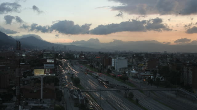 T/L, WS, HA, Traffic on highway, dusk to night, Bogota, Colombia