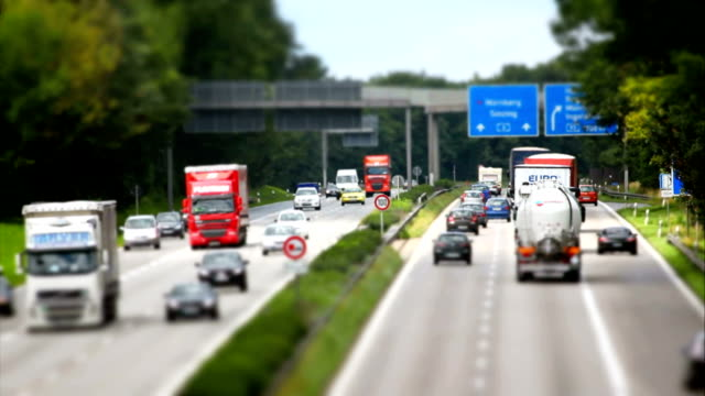 traffic on highway tilt shift effect - heavy goods vehicle stock videos & royalty-free footage