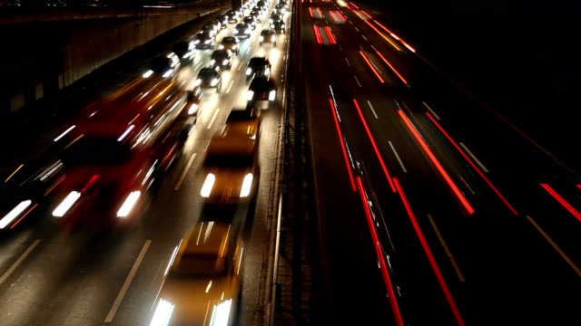 traffic on highway, time lapse - ora di punta video stock e b–roll