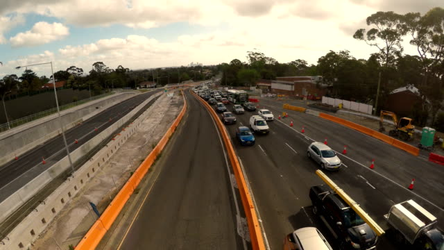 traffic on highway with new road construction - roadworks stock videos & royalty-free footage