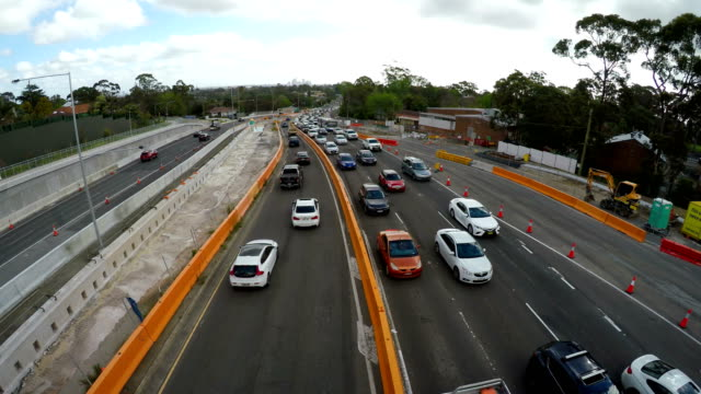 traffic on highway with new road construction - tarmac stock videos & royalty-free footage