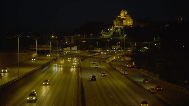 high angle wide shot traffic on highway with pacific tower on beacon hill in background in seattle at night - seattle stock videos & royalty-free footage