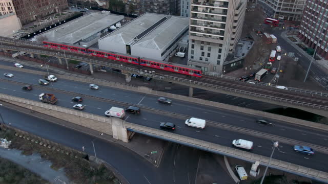 traffic on highways and elevated train in city, london, uk - elevated train stock videos & royalty-free footage