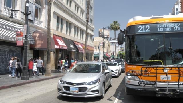 traffic on hollywood boulevard, hollywood, los angeles, california, united states of america, north america - hollywood boulevard stock videos & royalty-free footage
