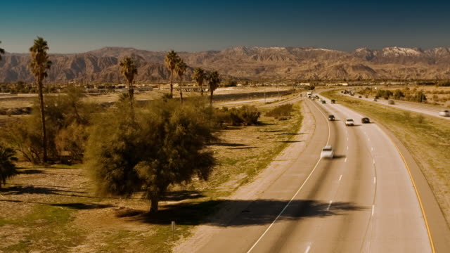 T/L, WS, Traffic on Interstate 10 in Coachella Valley, mountains in background, Indio, California, USA