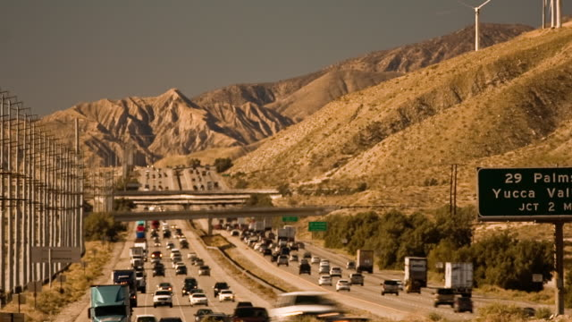 T/L, WS, Traffic on Interstate 10, San Jacinto mountains in background, North Palm Springs, California, USA