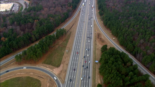 traffic on interstate 40  - aerial view - north carolina,  wake county,  united states - american interstate stock videos & royalty-free footage