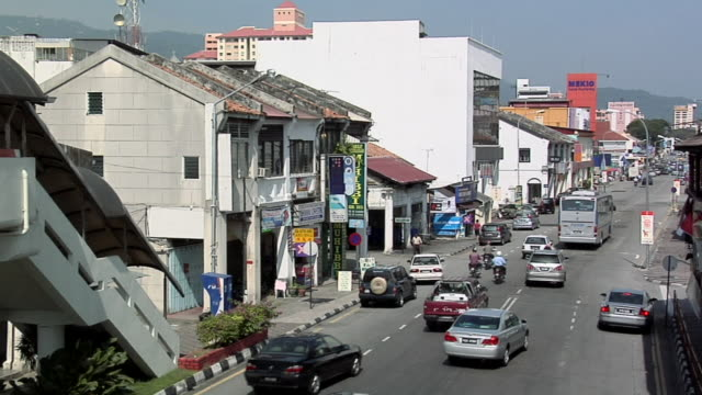 ws traffic on jalan burma street / george town, penang, malaysia - penang stock videos and b-roll footage
