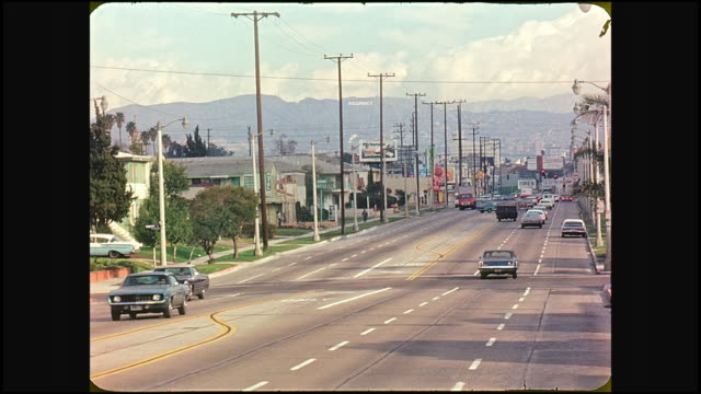 1974 traffic on la brea ave near pickford street intersection looking north towards hollywood hills and hollywood sign in far distance - hollywood california stock videos & royalty-free footage