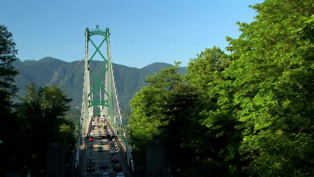 ws ha traffic on lion's gate bridge, vancouver, british columbia, canada - suspension bridge stock videos & royalty-free footage