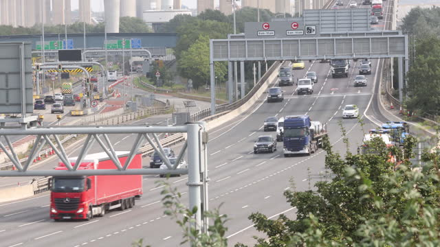 traffic on m25 motorway full of trucks and hgv's , in dartford, kent, u.k., on friday, september 3, 2021. - on the move stock videos & royalty-free footage