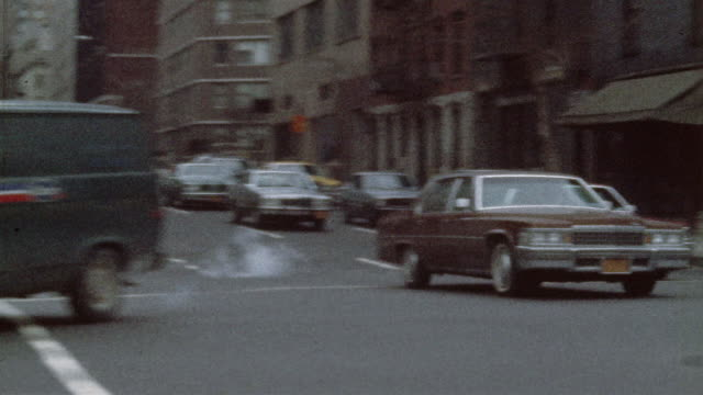 1978 ms pan traffic on manhattan street, new york city, new york state, usa - 1978 stock videos and b-roll footage