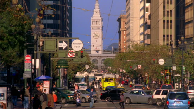 WS, Traffic on Market Street, Ferry Building tower in background, San Francisco, California, USA