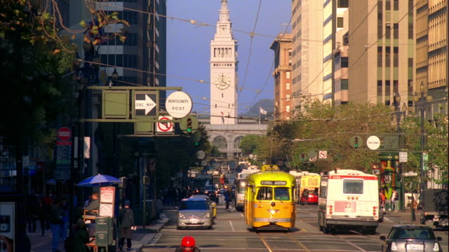 ms, traffic on market street, ferry building tower in background, san francisco, california, usa - san francisco ferry building stock videos & royalty-free footage