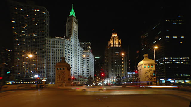 t/l ws traffic on michigan avenue at night, chicago, illinois, usa - tribune tower stock-videos und b-roll-filmmaterial