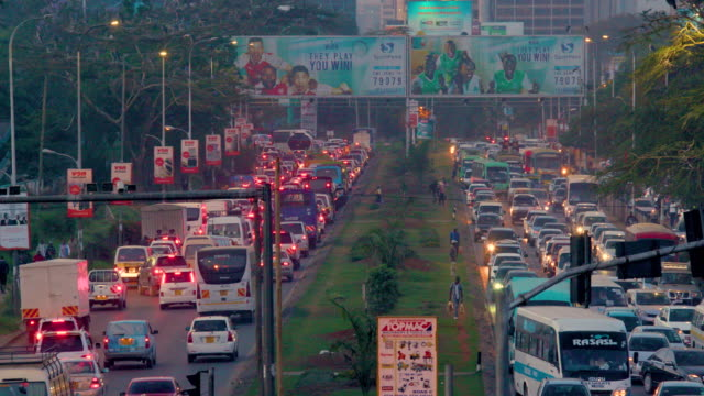 traffic on mombasa road nairobi  kenya  africa - bus billboard stock videos & royalty-free footage