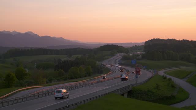 Traffic on motorway A8 at sunset. Upper Bavaria, Bavaria, Germany, Europe.
