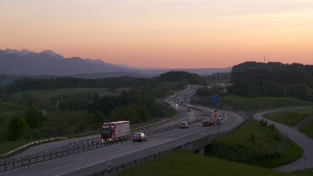 Traffic on motorway A8 at sunset. Upper Bavaria, Bavaria, Germany, Europe.