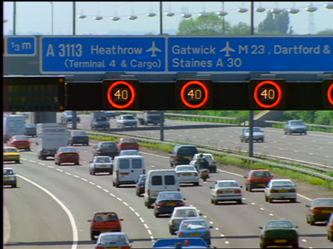 "traffic on motorway drving benath ""heathrow""  & ""gatwick"" airport road signs - heathrow airport stock videos and b-roll footage"