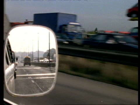 traffic on motorway seen in wing mirror - wing mirror stock videos & royalty-free footage