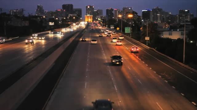 HA WS Traffic on multiple lane freeway towards city downtown at night, San Diego, California, USA