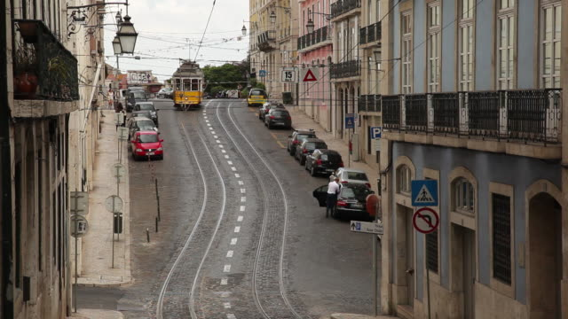ws traffic on narrow old town street / lisbon, portugal - narrow stock videos and b-roll footage