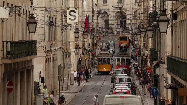 WS Traffic on narrow old town street / Lisbon, Portugal