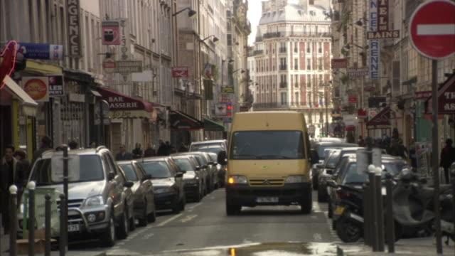 ms traffic on narrow street, paris, france - narrow stock videos & royalty-free footage