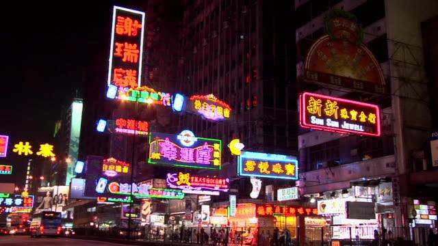 ws traffic on nathan road illuminated at night / hong kong, china - tsim sha tsui stock videos & royalty-free footage