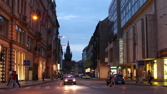 WS Traffic on old town street at dusk / Prague, Czech Republic