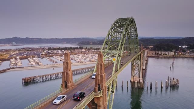 traffic on oregon coast highway crossing yaquina bay bridge - aerial view - 1936 stock videos & royalty-free footage