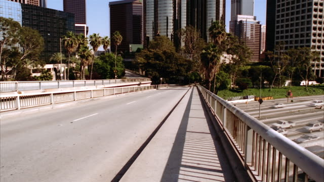 T/L, MS, Traffic on overpass, office buildings in background, Los Angeles, California, USA