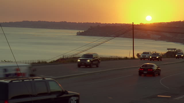 ws traffic on pacific coast highway at sunset / malibu, california, usa - california sunset stock videos & royalty-free footage