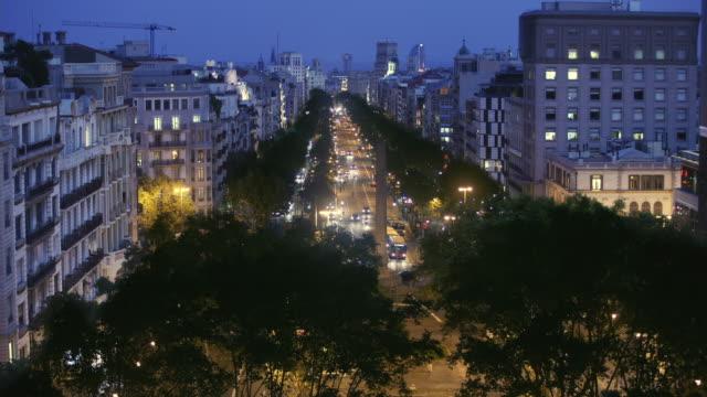 T/L HA WS Traffic on Passeig de Gracia at night / Barcelona, Catalonia, Spain