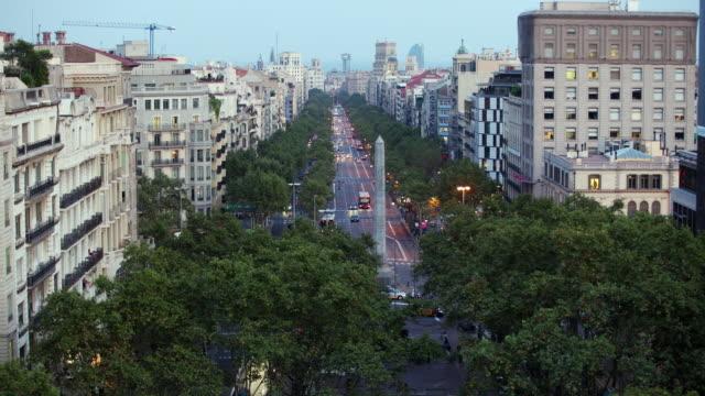 T/L HA WS Traffic on Passeig de Gracia, day to night / Barcelona, Catalonia, Spain