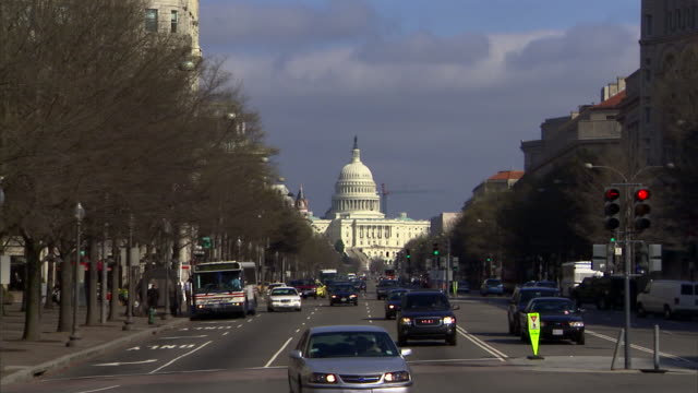 Traffic on Pennsylvania Avenue drives by the Capitol Building in Washington, D.C.