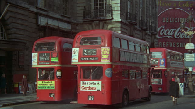 1966 ws pan traffic on piccadilly circus / london, united kingdom - piccadilly stock videos & royalty-free footage