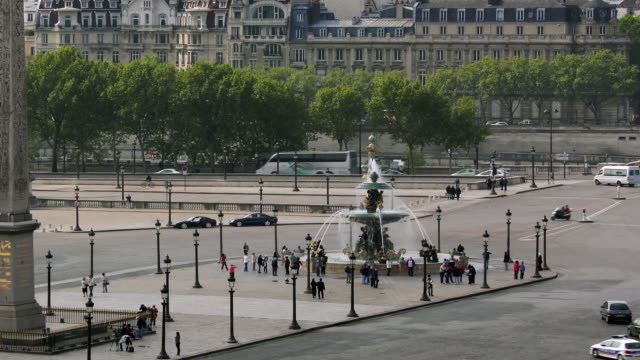 T/L MS ZO WS HA Traffic on Place de la Concorde with Fountain of River Commerce and Navigation and Obelisk of Luxor / Paris, Ile de France, France